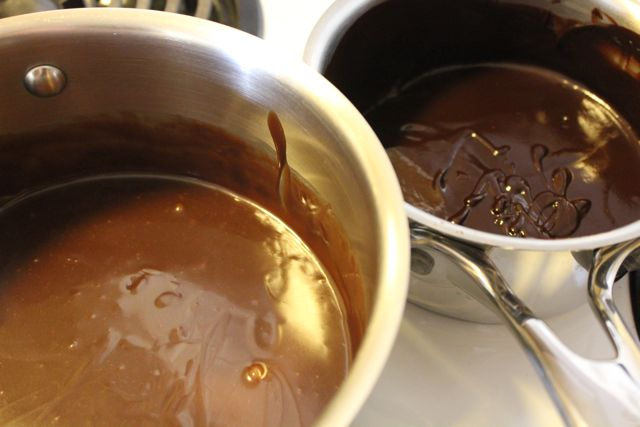 Pot of milk and pot of dark chocolate